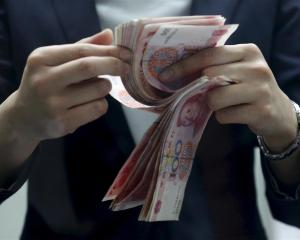 The People's Bank of China has  pumped more money into the market this week. Photo by Reuters.