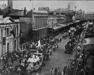 Peace day celebrations in Timaru: the procession in Stafford St, with the fire brigade leading. -...