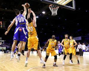 Shane Temara blocks a shot for the Wellington Saints against the Taranaki Mountainairs in this...