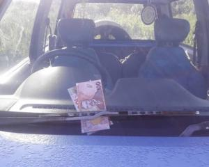 Money was left under the windscreen wipers of the cars at the campground near Westport. Photo:...