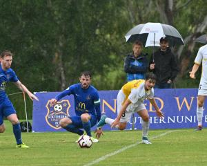 Southern United midfielder Danny Ledwith (left) runs on to a loose ball as team-mate Conor O...