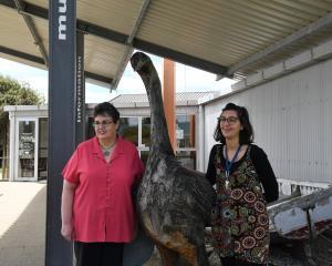 Owaka Museum director Massimiliana (Massi) Urbano and volunteer Karen Kinley with a moa statue at...