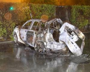 The burnt-out wreckage of a car in which three teens died in Christchurch. Photo / NZ Police