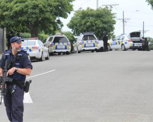 Armed police execute search warrants at a Hull St address in Oamaru earlier this month. Photo:...