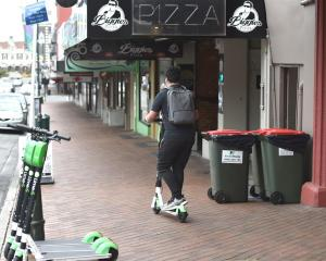 A Lime scooter rider in Dunedin. Photo: ODT