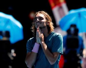 Stefanos Tsitsipas reacts after his victory over Roberto Bautista Agut. Photo: Reuters