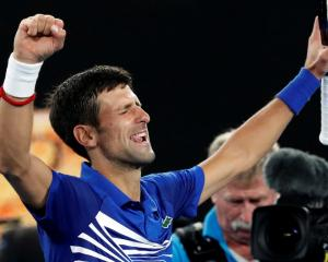 Novak Djokovic celebrates his victory over Lucas Pouille. Photo: Reuters