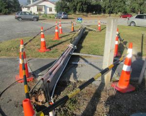 A power pole at Dunstan Hospital lies on the ground last week after it fell last Tuesday. Photo:...