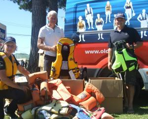Helping boat users upgrade their old lifejackets are (from left) Sue Tucker, Shayne Hitchcock and...