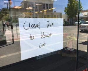 A sign at Alexandra's Westpac bank advises of closure this afternoon because of a power cut....