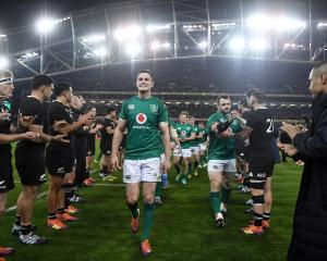 The All Blacks congratulate Ireland on their 16-9 test win in Dublin earlier this month. Photo:...