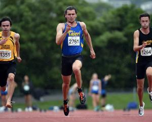 Felix McDonald (centre) heads the 100m sprint with Schuyler Orr (left) and Cameron Miller running...