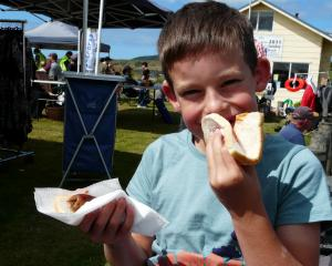 Lachlan Mason (7), of Invercargill, satisfies a big appetite during the Kaka Point Annual Beach...
