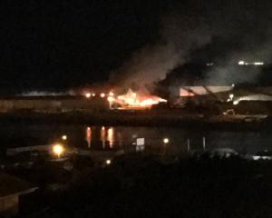 A blaze burns at a large warehouse in Bluff overnight. Photo: Fiona Mathiassen