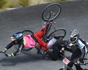 Dunedin's Nic Butler (left) falls with Louis Hunt, of Cambridge, during a 13-14  BMX cruiser...