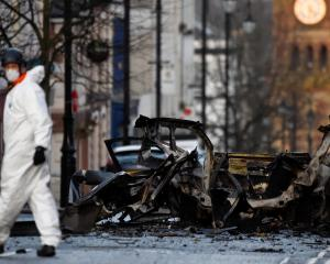 A forensic officer is seen at the scene of a suspected car bomb in Londonderry. Photo: Reuters