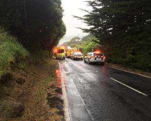 Emergency services at the scene of a crash on Highcliff Rd this afternoon. Photo: Peter McIntosh