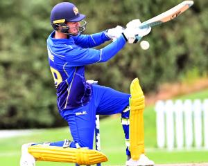 Otago Volts batsman Josh Finnie looks to ramp the ball.