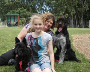 Colleen Wells and daughter Lily (9), of Invercargill,  with their dogs,  Bonnie (left) and Poppy,...