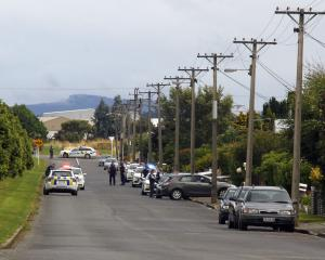Police stand guard outside a house in Drury Lane in the Invercargill suburb of Grasmere  where...