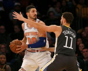 Knicks big man Enes Kanter in action against Golden State Warriors guard Klay Thompson earlier...