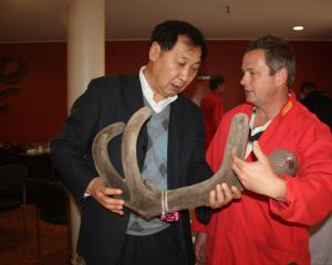 Deer Industry NZ Asia markets manager Rhys Griffiths (right) with Professor of Chinese Medicine...