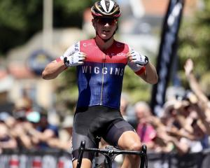 James Fouche celebrates winning overall honours in the national men's road cycling race in Napier...