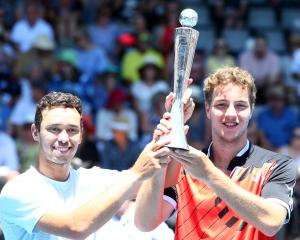 Ben McLachlan (left), of Japan,  and Jan-Lennard Struff, of Germany,  celebrate with the trophy...