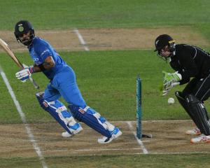India's Virat Kohli plays a shot in the first ODI against New Zealand in Napier on Wednesday....