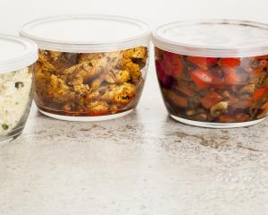 Pack leftovers into microwave-safe storage containers and refrigerate to take to work for lunch...