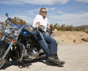 Motorcycles and soft-top convertibles are among the archetypal responses to a male mid-life...