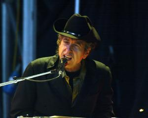 Bob Dylan performs in England in 2004. Photo: Getty Images