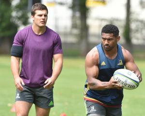 Highlanders loose forward Dillon Hunt (left) and wing Waisake Naholo goe through drills at team...