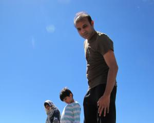 Asma, Qasim (5) and Mustafa Khan, of Auckland, look for significant Pakistan dates in Wanaka's...
