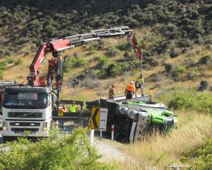 Workers prepare to recover a Summerlands freight truck carrying dangerous goods that crashed in...