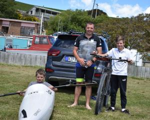Kathmandu Coast to Coast bound Craig Lay prepares his gear with sons Rhys (8) trying out the...