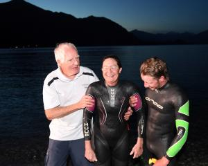 Wanaka swimmer Fiona Fairbairn is supported by her father, David Strang, and son, Finn Fairbairn,...