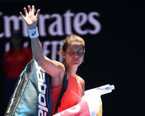 Julia Goerges of Germany leaves the court following defeat in her first round match against...