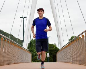 Kashi Leuchs runs over the bridge across the Leith last month in preparation for the Coast to...