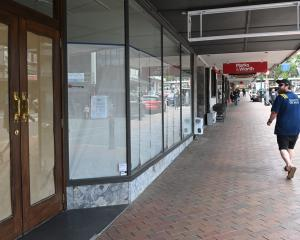 The Madam Woo restaurant in Dunedin, with its windows papered over and its closing notice. The...