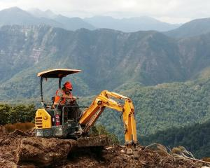A mini-digger works on Paparoa Track. PHOTO: DEPARTMENT OF CONSERVATION