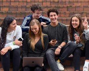 Sharing their NCEA level 3 results in Dunedin's Octagon yesterday, are (from left) former St...