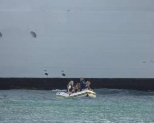 The inflatable boat had four people on board. Photo: Aaron Randell