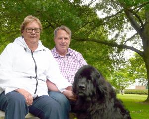 Clutha District Council chief executive Steve Hill, wife Lana and pet Newfoundland Maddie relax...