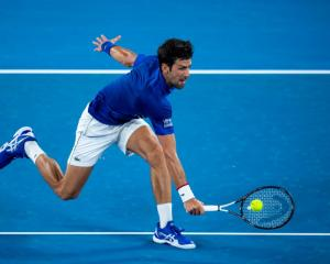 Novak Djokovic reaches to play a backhand during his second round win last night in Melbourne....