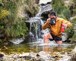 Dave Viitakangas, of Queenstown,  stops for a quick drink and some food on his way to checkpoint...