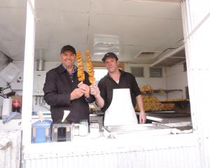 Palmerston and Waihemo A&P Association president Garry Dodd (left), shown cooking his Curly...