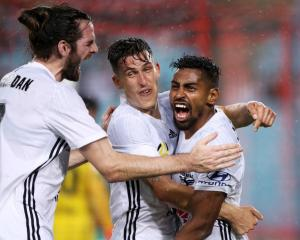 Cillian Sheridan and Louis Fenton of the Phoenix embrace Roy Krishna during the side's win over...