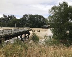 Pyramid Bridge, halfway between Waikaia and Waikaka, was washed away in February last year and...