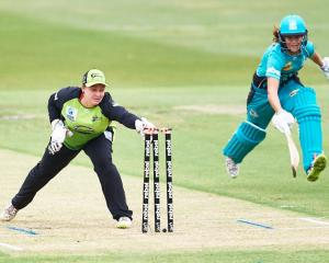 Rachel Priest playing for the Sydney Thunder runs out the Brisbane Heat's Josie Dooley in the...